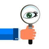 Magnifying glass in hand eye Stock Photography