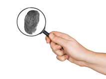 Magnifying glass in hand and fingerprint Stock Image