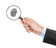Magnifying glass in hand and fingerprint Stock Images