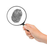 Magnifying glass in hand and fingerprint Stock Photos
