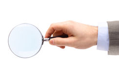 Magnifying glass in hand isolated Stock Images