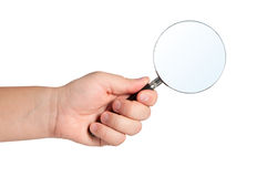 Magnifying glass in hand isolated. Royalty Free Stock Images