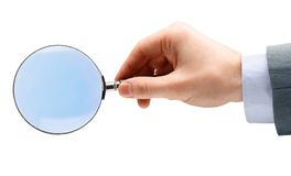 Magnifying glass in hand isolated Royalty Free Stock Photos