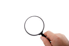 Magnifying glass in hand isolated Royalty Free Stock Photo