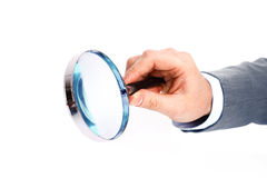 Magnifying glass in hand Royalty Free Stock Photography