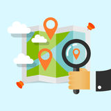 Magnifying glass in hand. Search locations on the map Stock Photo
