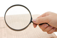 Magnifying glass in hand and text Stock Images