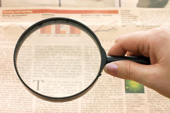 Magnifying glass in hand and text royalty free stock image