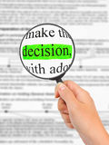 Magnifying glass in hand and word Decision Royalty Free Stock Photos