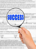 Magnifying glass in hand and word Success Royalty Free Stock Images