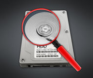 Magnifying glass on hard disk drive Royalty Free Stock Photography