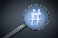 Magnifying glass hashtag sign. 3d rendering of a magnifying glass hashtag sign Royalty Free Stock Image