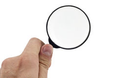 Magnifying glass holding human hand. On isolated white background Royalty Free Stock Images