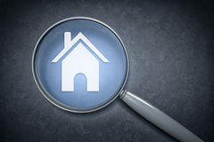 Magnifying glass home. 3d rendering of a magnifying glass with a home sign Stock Image