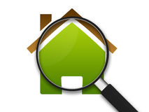 Magnifying Glass - House. Magnifying Glass zooming in on a clipart house Stock Photo