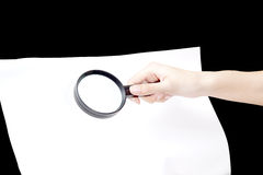 Magnifying glass hovering over Stock Image