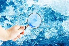 Magnifying glass and ice crystals Stock Photo