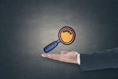 Magnifying glass icon on blackboard royalty free stock photos