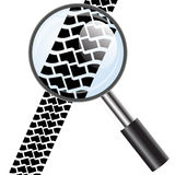 Magnifying glass icon, trail tires. Royalty Free Stock Photos