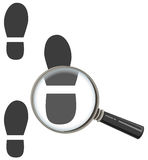 Magnifying glass increases footprint of man Stock Photo