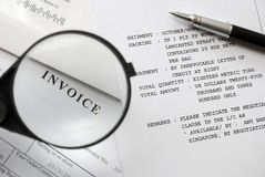 Magnifying glass on invoice Stock Photo
