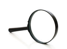Magnifying glass isolated over white Stock Photography