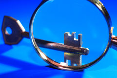 Magnifying Glass And Key Royalty Free Stock Photo