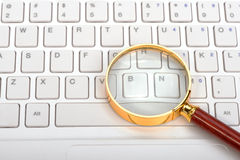 Magnifying glass on laptop c Stock Image