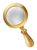 Magnifying glass with a large lens in a  gold frame with a handle for detective Stock Photos