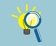 Magnifying glass with light bulb idea Stock Photo