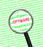 Magnifying glass locating spyware in computer code. Magnifying glass locating spyware in computer machine code Stock Photo