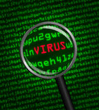 Magnifying glass locating a virus in computer code. Magnifying glass locating a virus in computer machine code Royalty Free Stock Photos