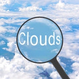 Magnifying glass looking Clouds Stock Photo