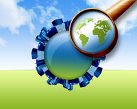 Magnifying Glass Looking Down at City Earth Royalty Free Stock Photos