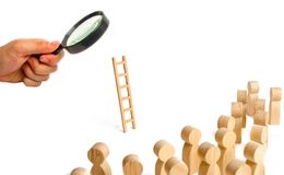 Magnifying glass is looking at the group of people looking at the ladder. career ladder. Promotion at work, business. Self-development, leadership skills stock photography