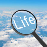 Magnifying glass looking Life Stock Photography