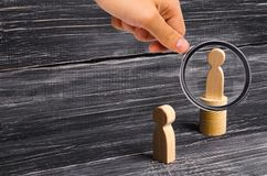 Magnifying glass is looking at the men stands on the podium and broadcasts his thoughts and ideas to listeners. royalty free stock images