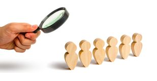 Magnifying glass is looking at the People stand in a formation on a white background. Discipline and order, submission. In anticip. Ation of an order. People stock photos