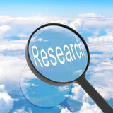 Magnifying glass looking Research Stock Images