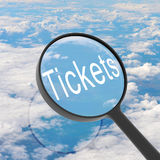 Magnifying glass looking Tickets Stock Photos