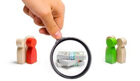 Magnifying glass is looking at the Two groups of people figures and a bunch of money between them. concept of the tender royalty free stock photos