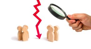 Magnifying glass is looking at the wooden red chart arrow down divides the two groups discussing the case. breaking ties. Contract. Break, conflict of interests stock photography