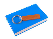 Magnifying glass lying on the book Royalty Free Stock Images