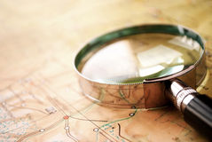 Magnifying glass lying on a map Royalty Free Stock Photo