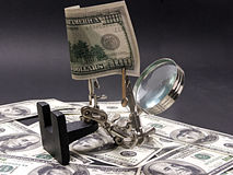 Magnifying glass man. Examining dollar bill Royalty Free Stock Photography