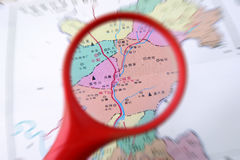 Magnifying glass and the map Stock Photos