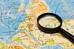 Magnifying glass and map Stock Photo