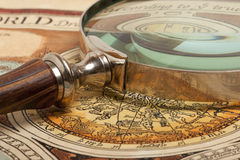 Magnifying glass and  map Stock Photos