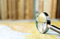 Magnifying glass on the map Royalty Free Stock Photos