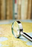 Magnifying glass on the map Stock Images